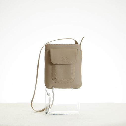 Cross body sling bag in beige leather