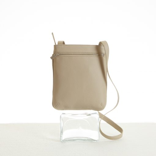 Pocket detail of beige cross body sling bag